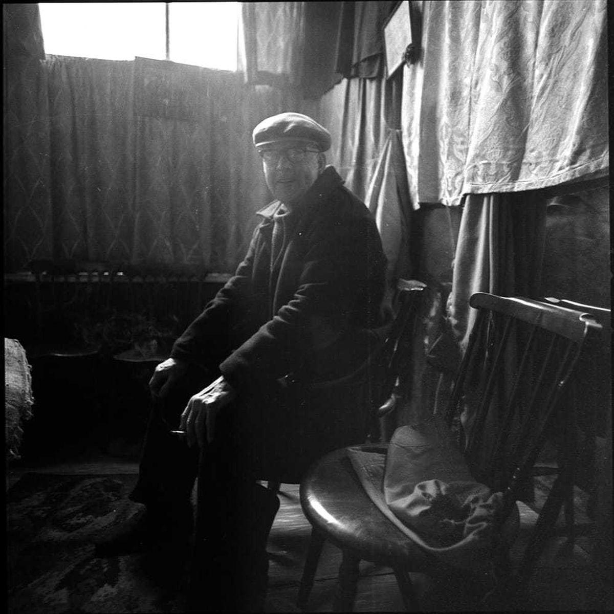 A man waiting for a haircut at Teddy McGovan's barbershop