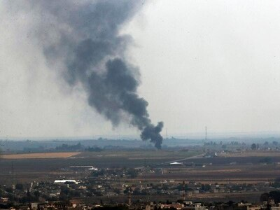 Kurds evacuate Syrian town in first pullout of Turkey ceasefire