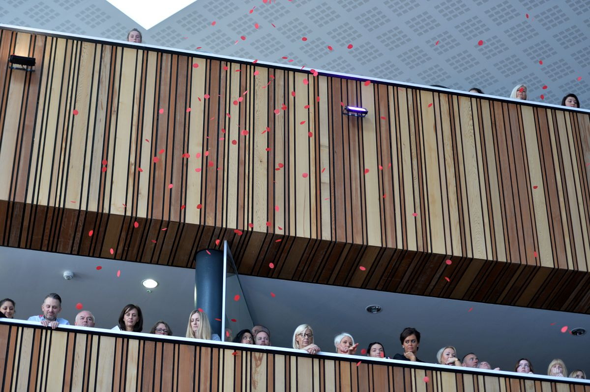 A shower of 40,000 poppies fall from the ceiling during the Remembrance Day service at Walsall College