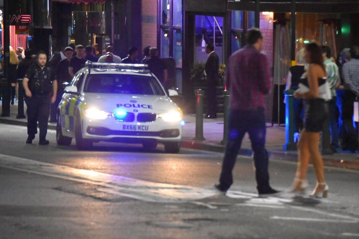 Police in Birmingham's Broad Street where many thousands of revellers flock each weekend. Picture: @snappersk