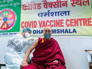 The Dalai Lama receiving a shot of the vaccine