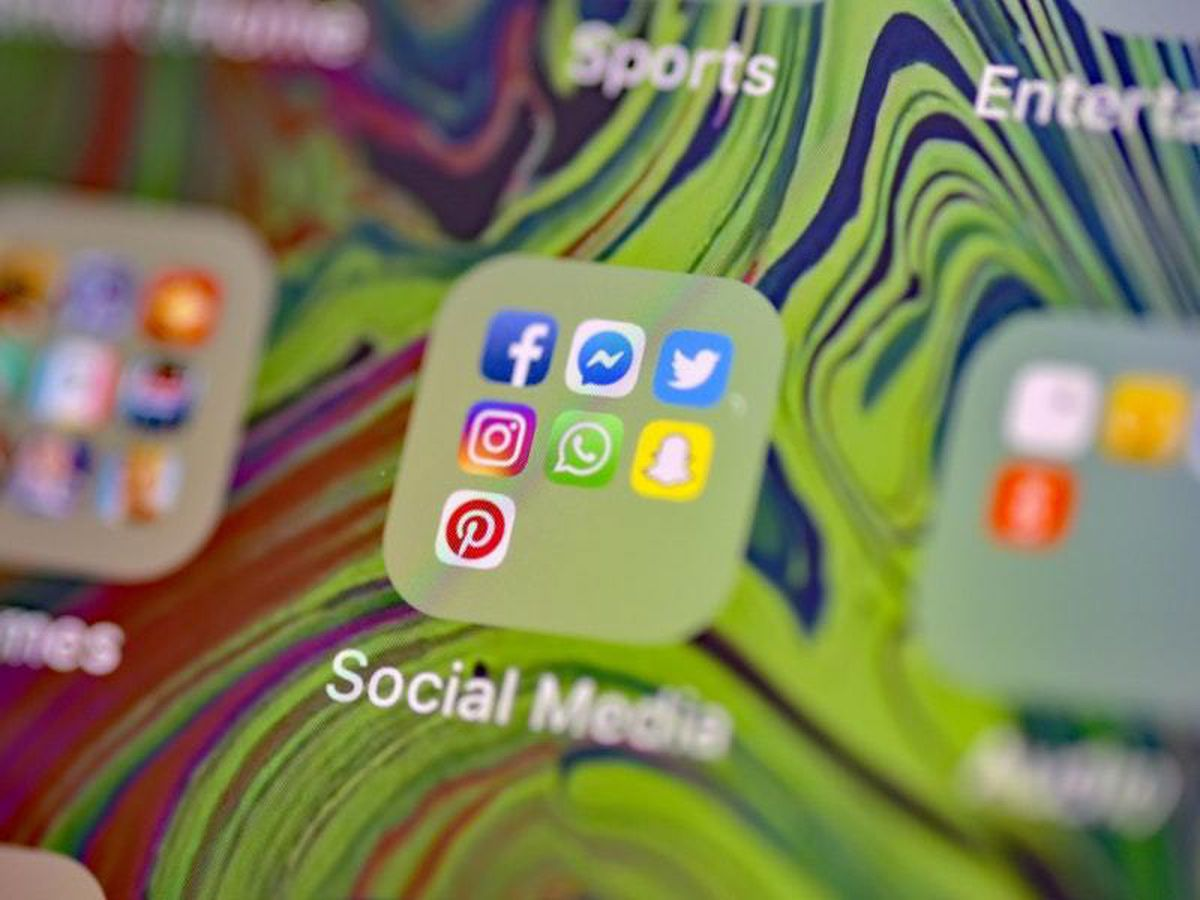 Facebook, Messenger, Twitter, Instagram, WhatsApp, Snapchat and Pinterest social media app icons on a smartphone