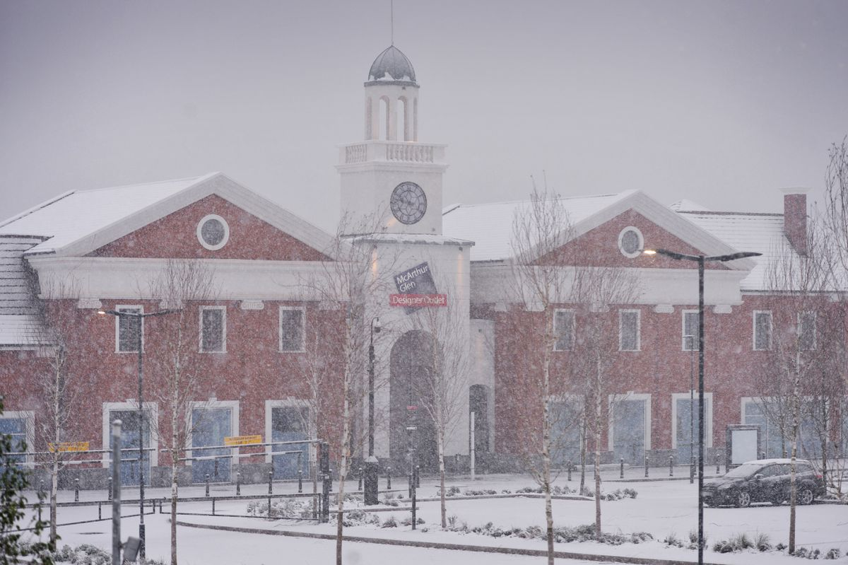 The Cannock McArthur Glen designer outlet is covered in winter snow as work continues