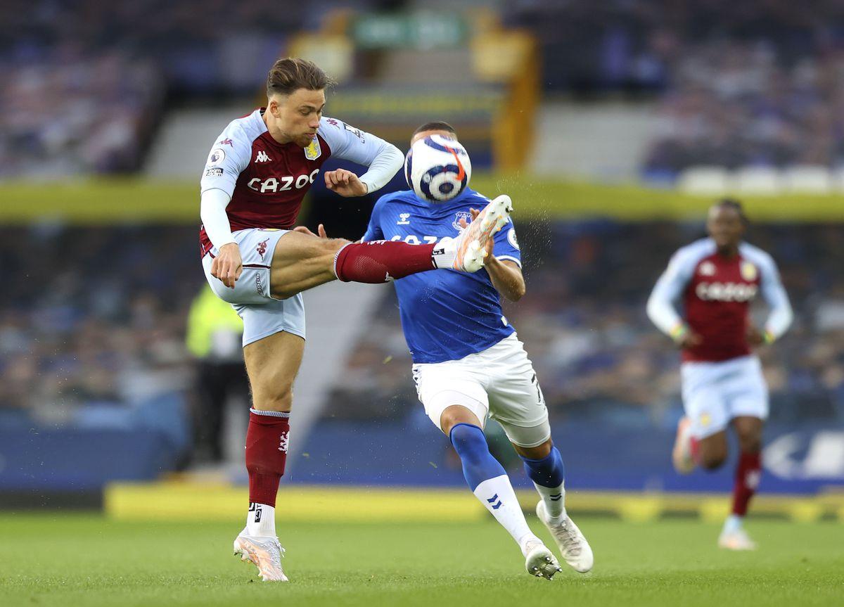 Aston Villa's Matty Cash (left) and Everton's Richarlison collide