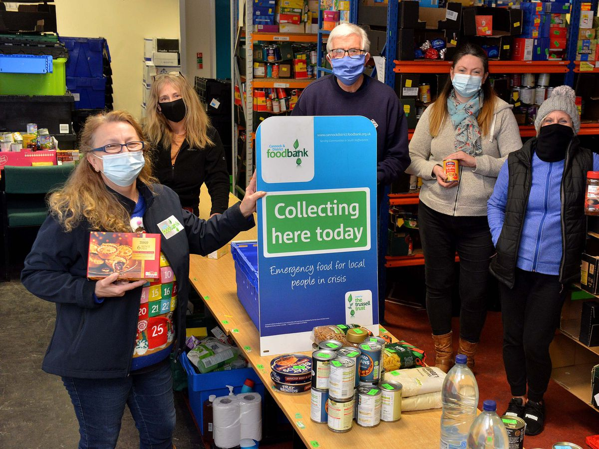 CANNOCK COPYRIGHT EXPRESS AND STAR STEVE LEATH 27/10/2020..Pic in Chadsmoor at the Cannock &  District Food Bank, pic for the Stars:  Feed a Family Campaign. At the front is Warehouse Manager: Vicki Pinter (number below). At the back: Sue Poulton, Ian Coulter, Sam Pearce and Annette Cotter..