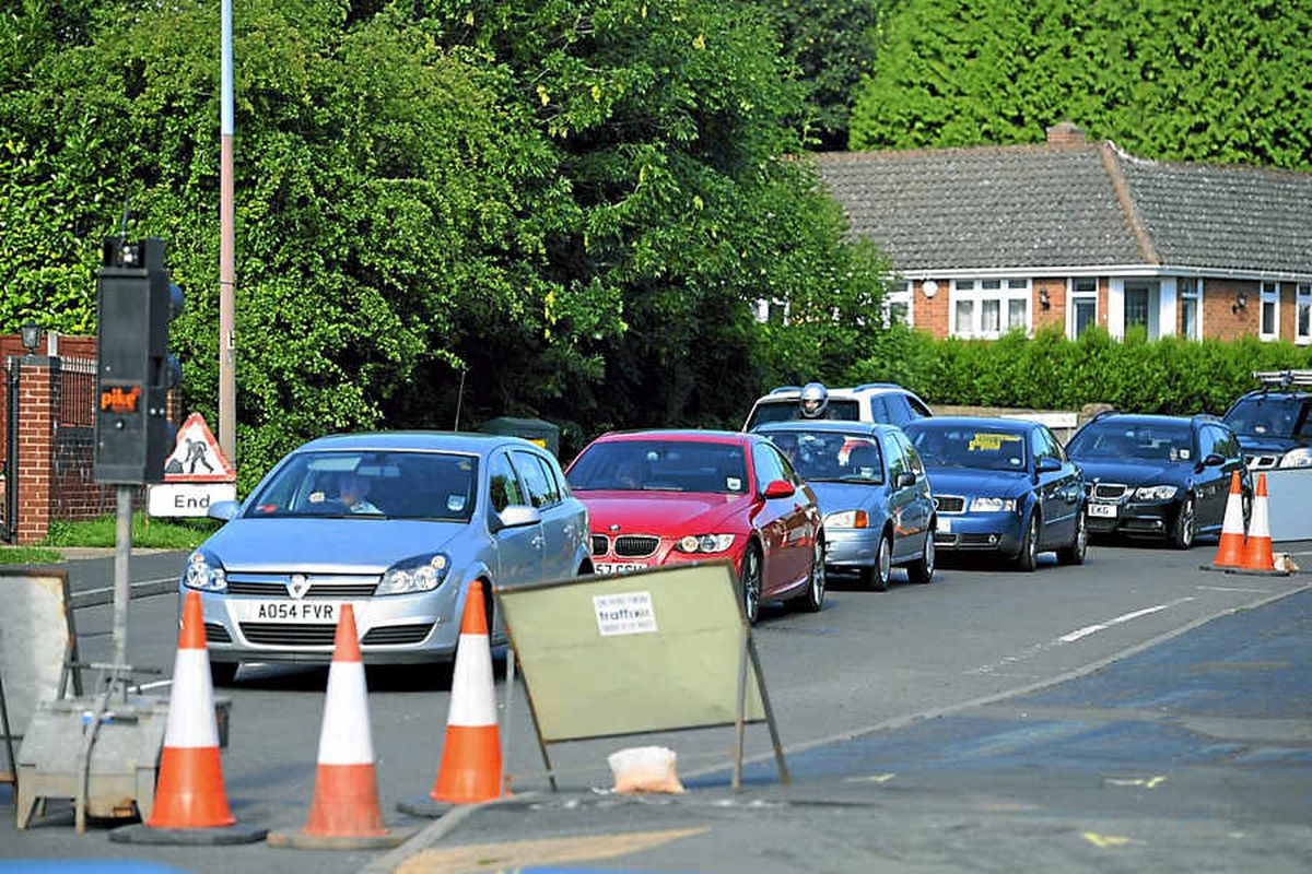 Three-way temporary traffic lights are in use until the end of this month, when roadworks are set to be completed