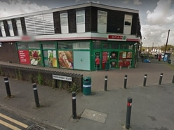 Masked raiders threaten shop staff with gun in Dudley