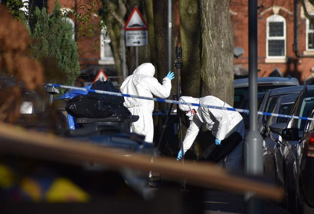 Forensic officers at the scene of the killing (Matthew Cooper/PA)