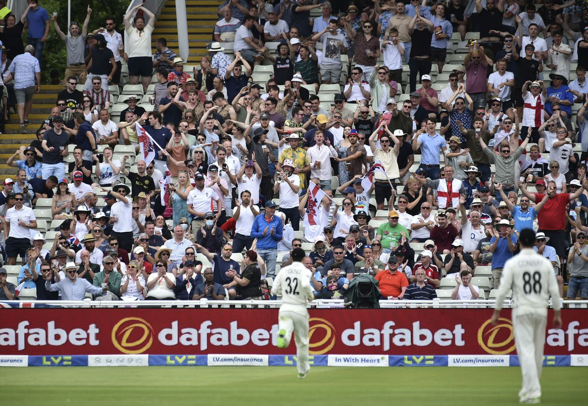 Supporters of England team cheer during the first day of the second cricket test match between England and New Zealand at Edgbaston