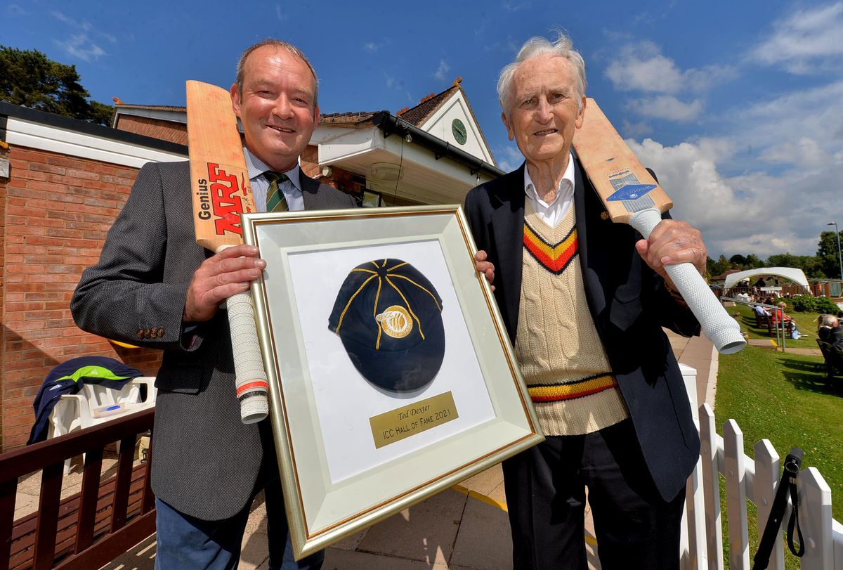 Wolverhampton Cricket Club chairman Mike Elphick presenting Ted Dexter with his ECB Hall of Fame cap in June 2021