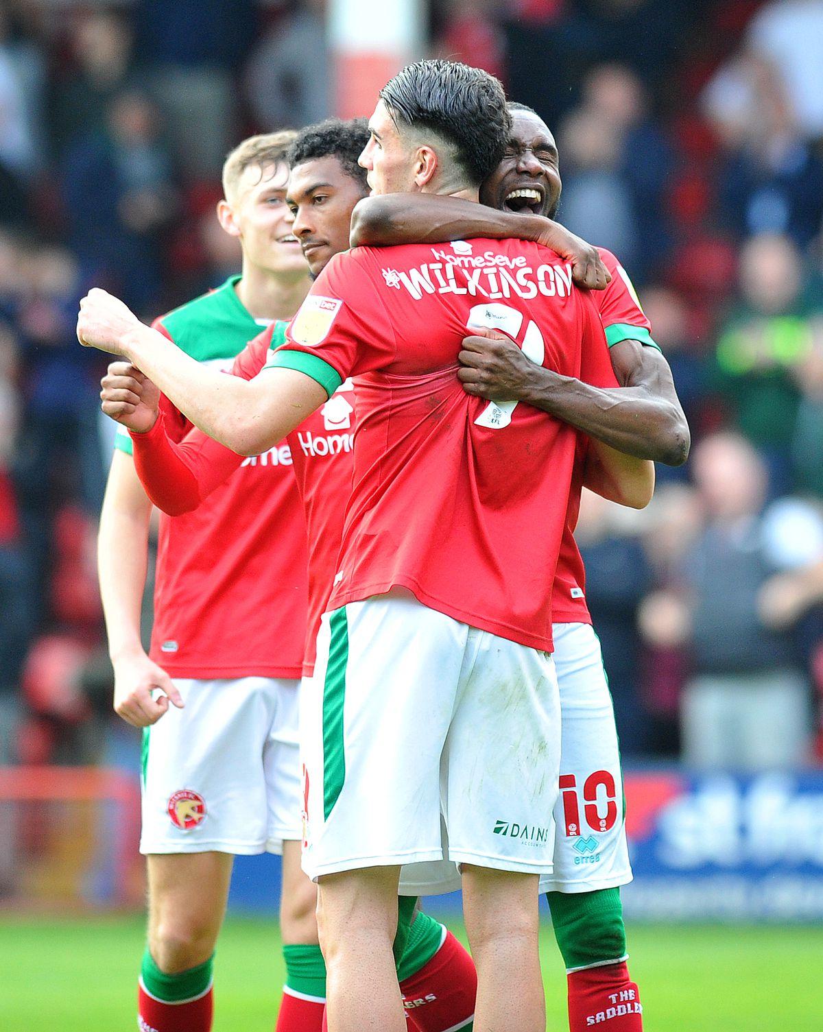 Emmanuel Osadebe congratulates Conor Wilkinson on his winner.