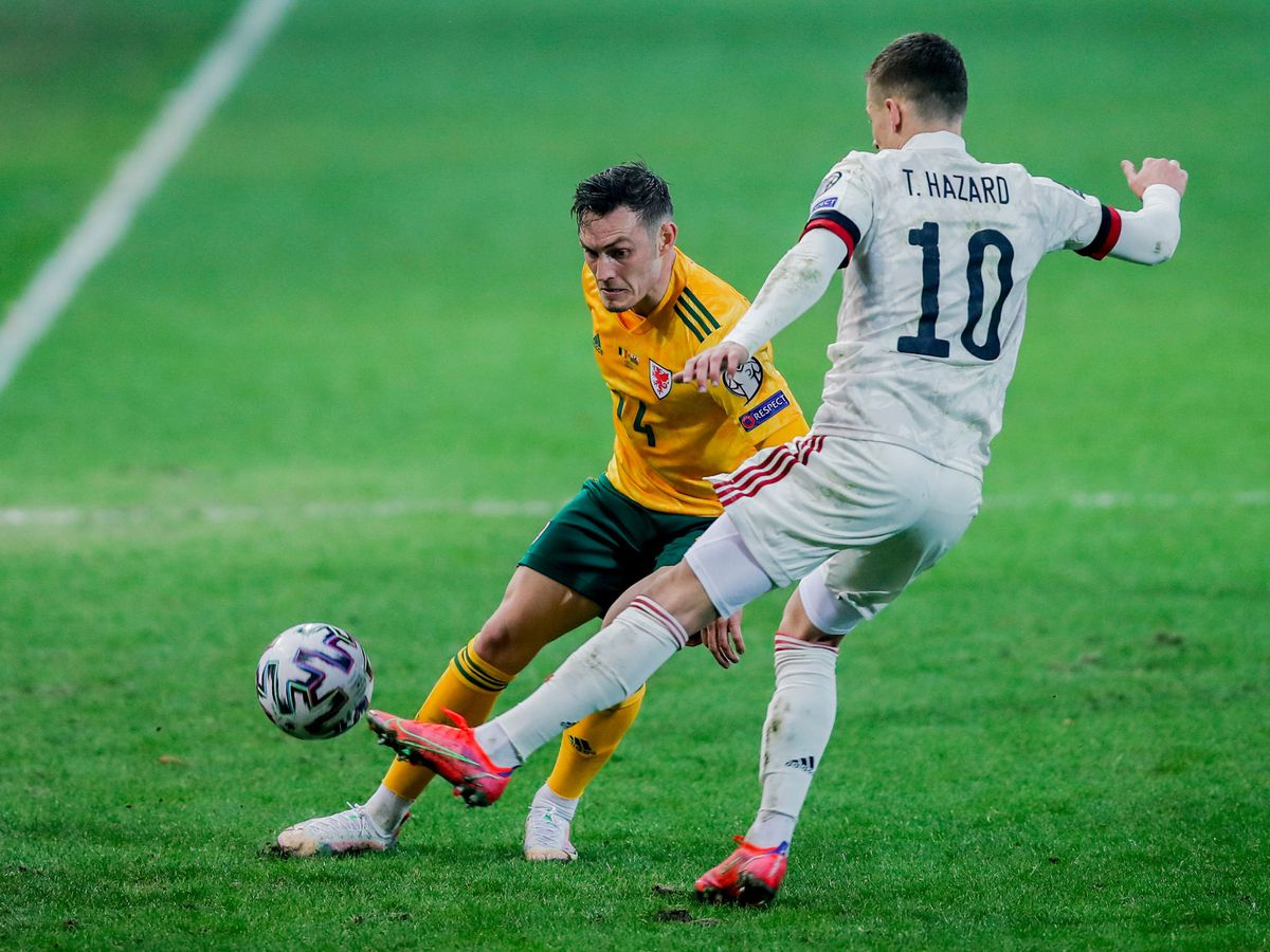 Connor Roberts (left) in action for Wales