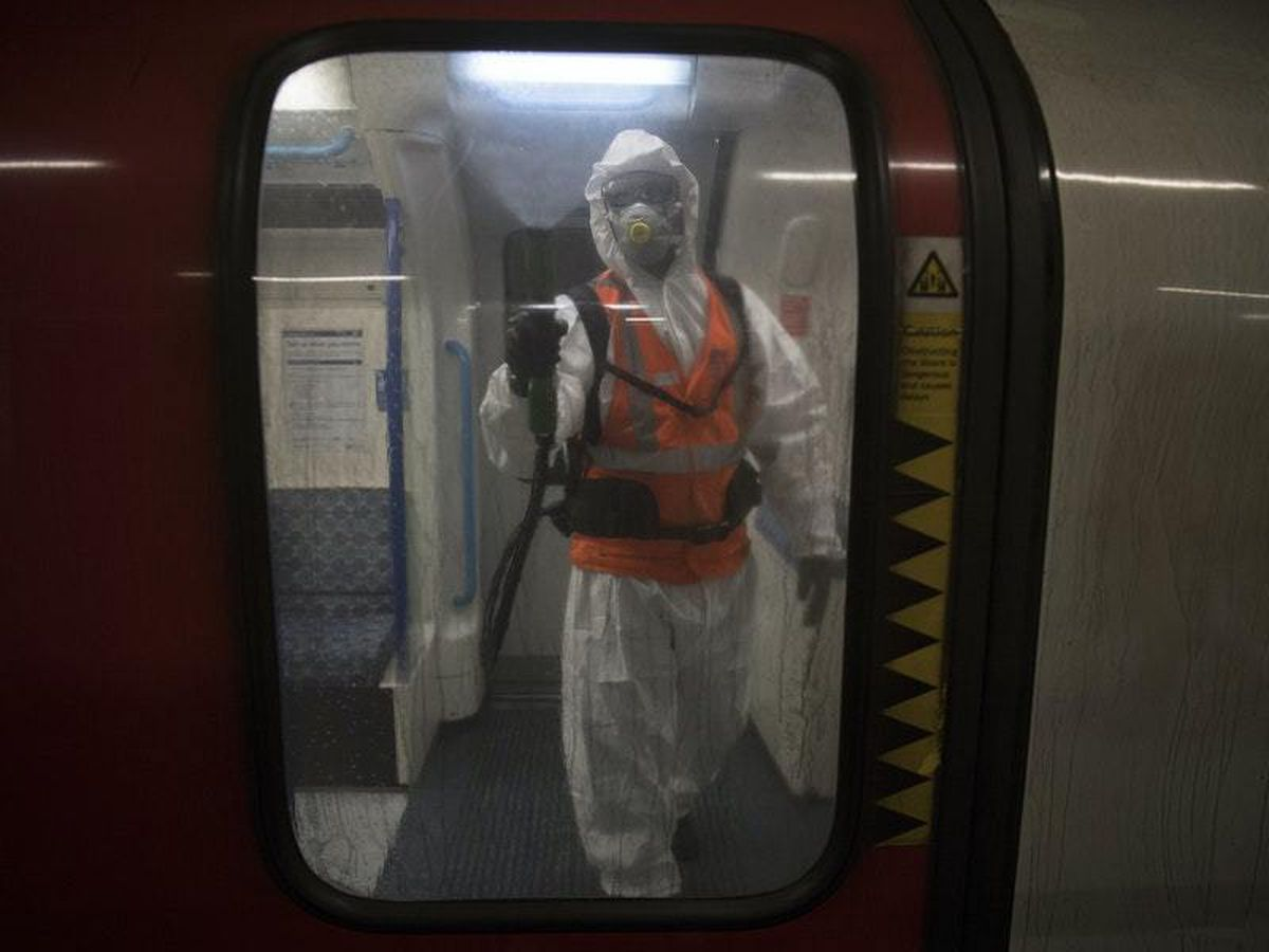 TfL worker sprays anti viral solution Zoono-71 inside a Tube train