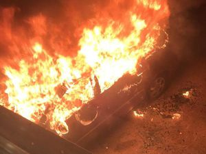 The car which was torched before the fire spread to the house