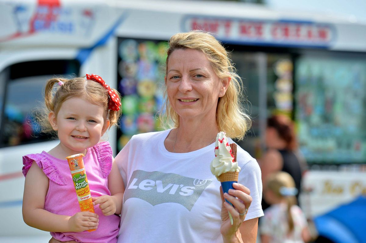 Lindsay Watkins and three-year-old Madison Watkins from Finchfield enjoy an ice cream on a hot summer day