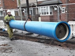 Work on track to replace burst water main in Tipton