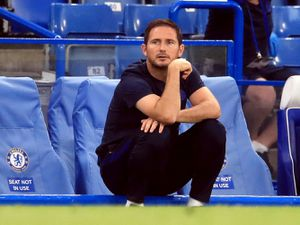 Frank Lampard sits down in front of the dugout