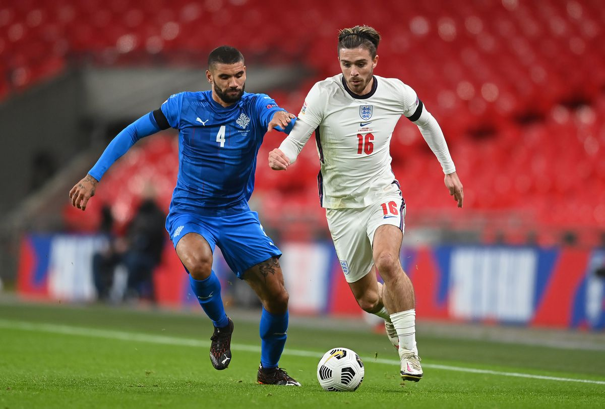 Iceland's Victor Palsson (left) and England's Jack Grealish