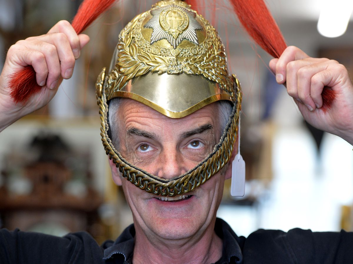 Windmill Antiques owner Ian Kettlewell wearing a horse guards helmet