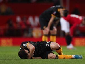Ruben Vinagre of Wolverhampton Wanderers goes down injured at full time.
