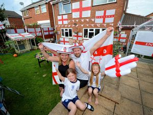 Dan Hill, with partner Sam Holloway and children Autumn and Cassidy, is showing his support for England