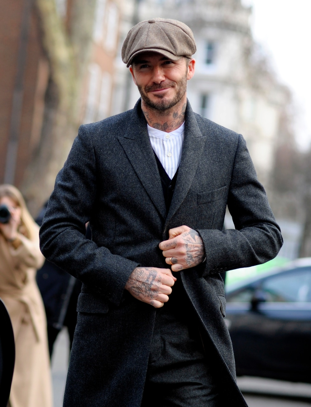 57cd74d4 David Beckham complete with flat cap during London Fashion Week. Photo by  Wayne Tippetts/REX/Shutterstock