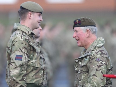 Prince of Wales presents medals to soldiers returning from Afghanistan