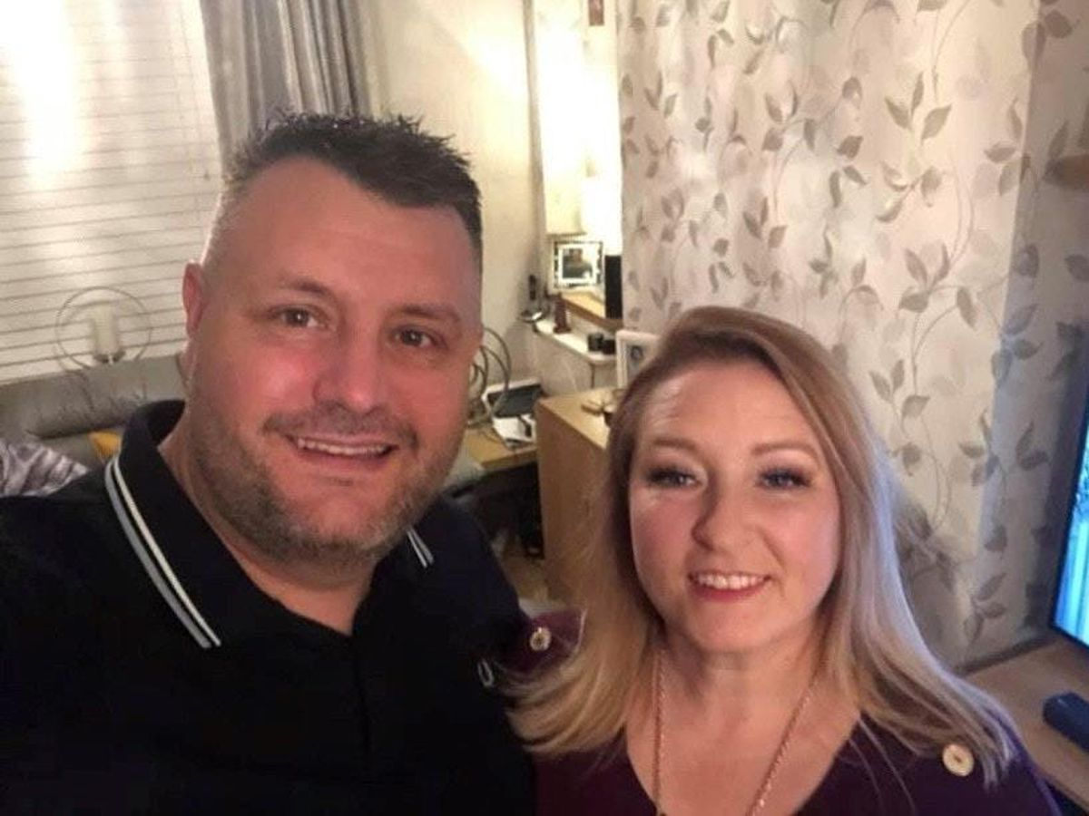 Cerys Wilkins, 48, with her husband Phil Wilkins, 50