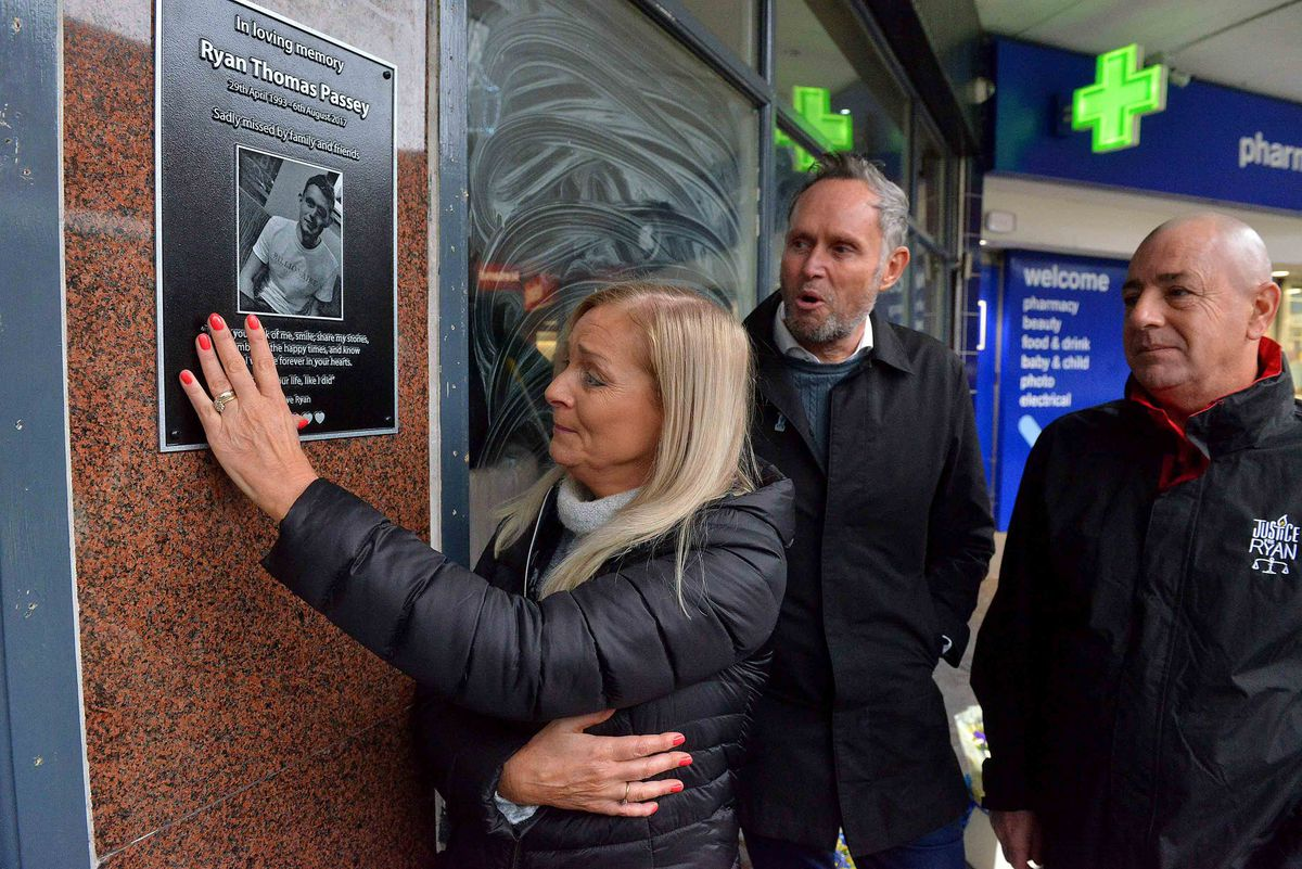 Unveiling the plaque in memory of Ryan Passey are his dad Adrian Passey, mom Gillian Taylor and step-dad Phil Taylor