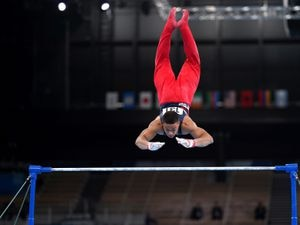 Great Britain's Joe Fraser on the horizontal bar during the Men's All-Around Final at the Ariake Gymnastics Centre on the fifth day of the Tokyo 2020 Olympic Games in Japan. Picture date: Wednesday July 28, 2021. PA Photo. See PA story OLYMPICS Gymnastics. Photo credit should read: Mike Egerton/PA Wire.    RESTRICTIONS: Use subject to restrictions. Editorial use  only, no commercial use without prior consent from rights holder.