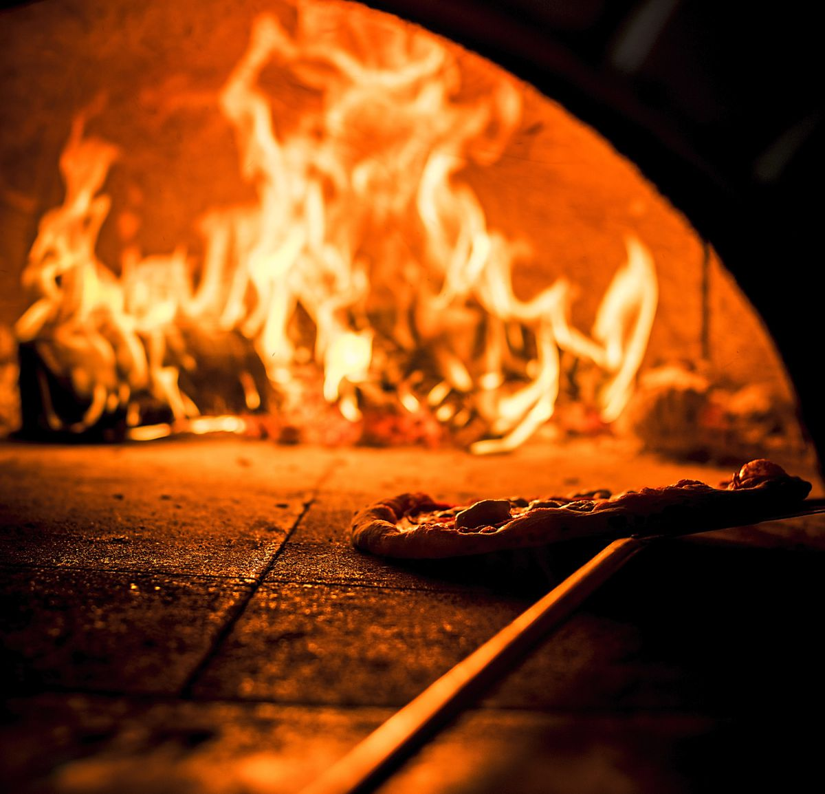 The pizzas are part-baked in wood-fired ovens
