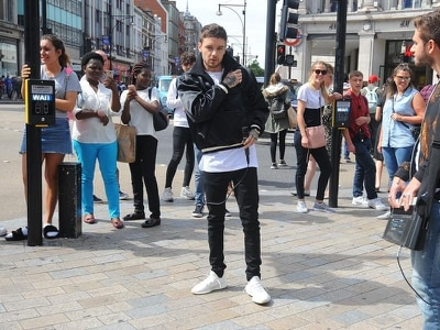 Liam Payne surprises fans by busking in Oxford Circus - WATCH