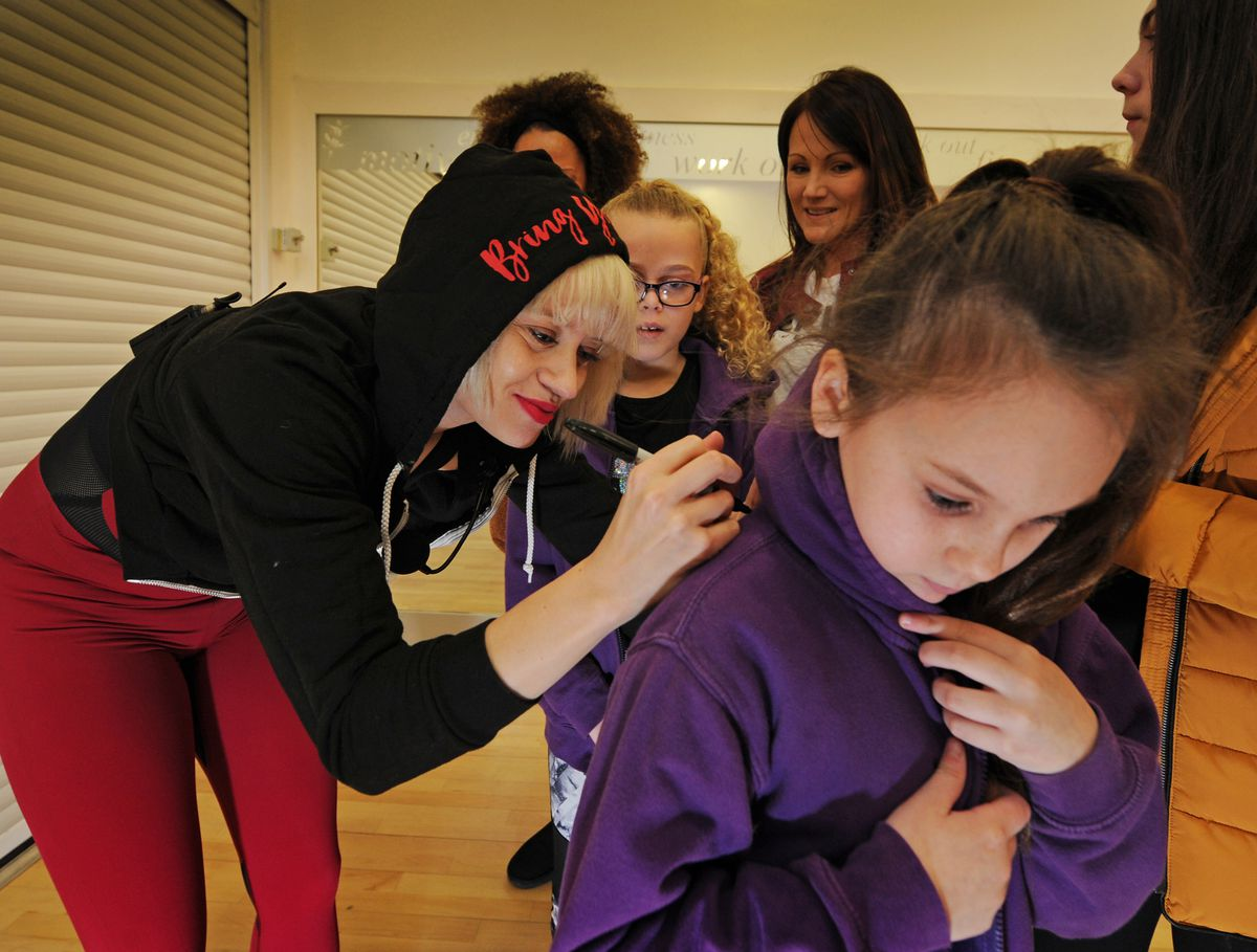 Kimberly Wyatt, during her visit to lead a dance class, signing autographs, at Haden Hill Leisure Centre, Cradley Heath