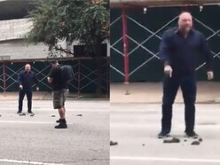 Watch Alex Jones scream at a pile of poo on the street for some reason