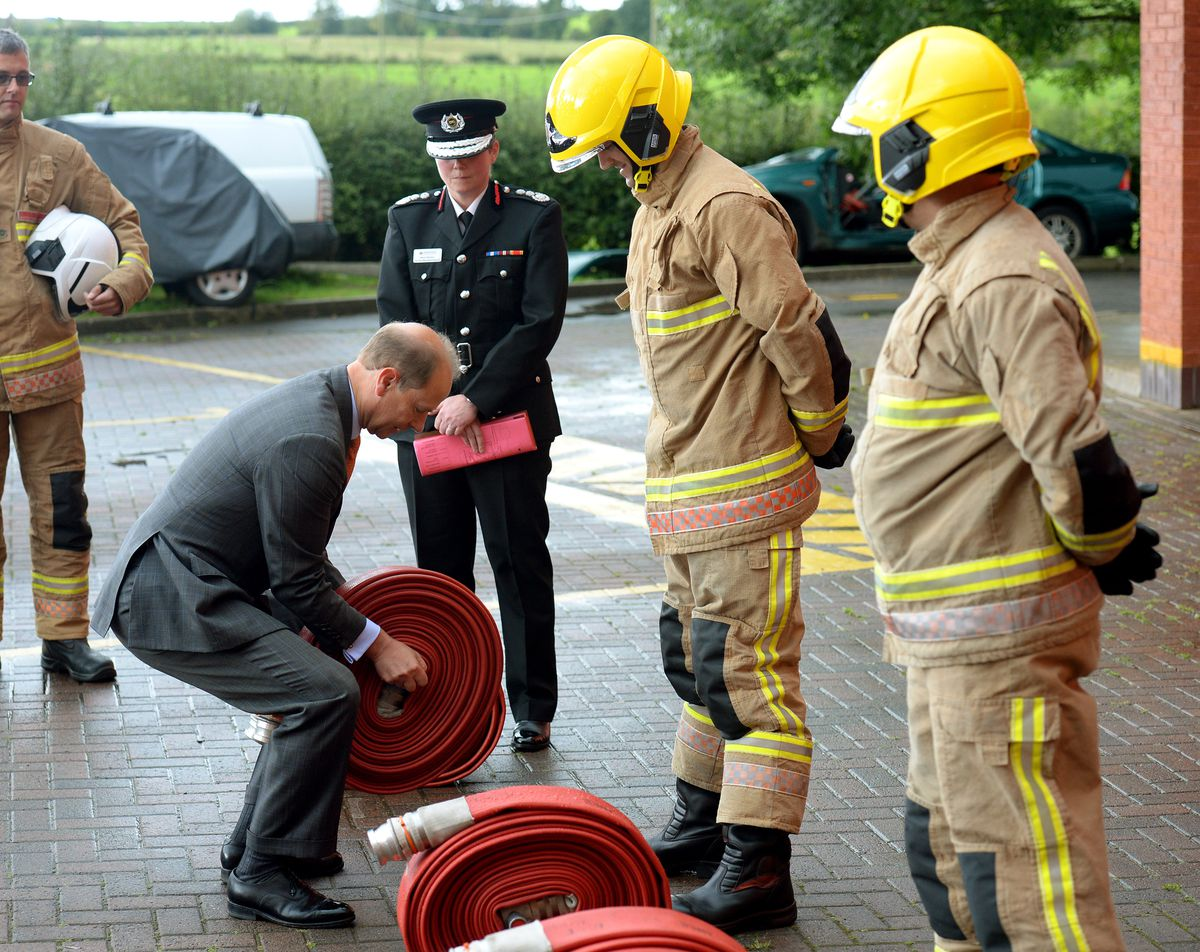 Prince Edward, Earl of Wessex, pictured during his visit to Staffordshire Fire and Rescue Service Headquarters, Pirehill, Stone..Feeling the weight of one of the hoses