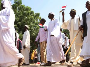 Sudanese protesters take part in a rally demanding the dissolution of the transitional government, outside the presidential palace in Khartoum, Sudan (Marwan Ali/AP)
