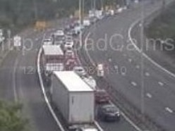 M5 tailbacks as motorway closed after lorry sheds metal load