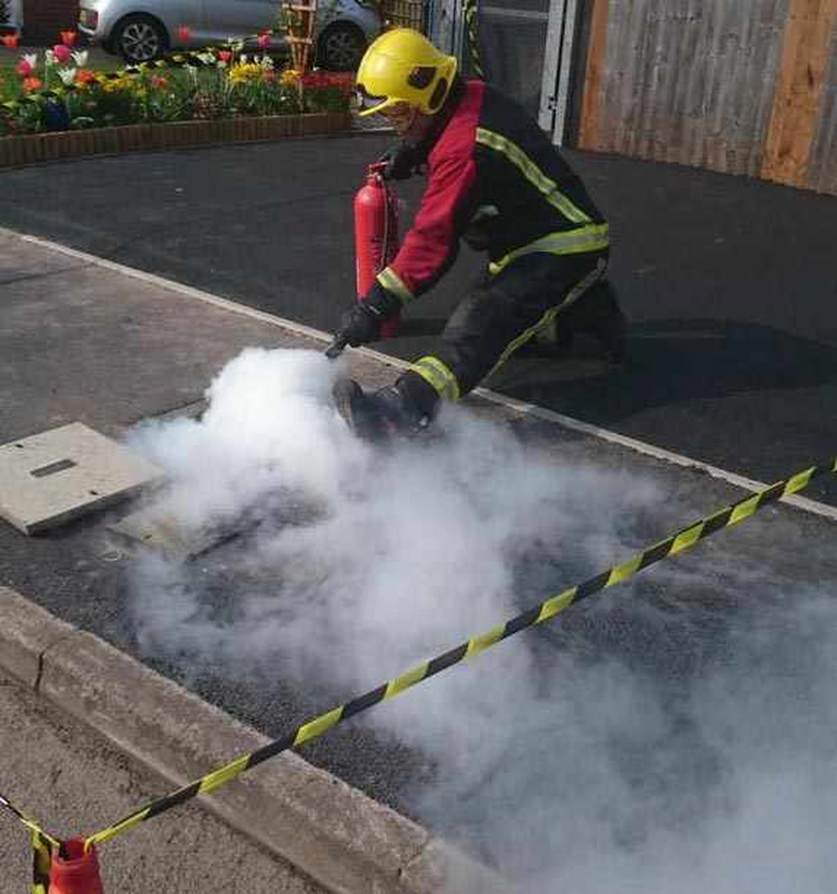 Firefighters tackle a fire coming from an underground electrical cable, in Barbrook Drive, Amblecote, picture: Stourbridge Fire Station