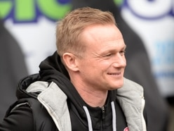 Corey Blackett-Taylor gives Dean Keates food for thought at Walsall