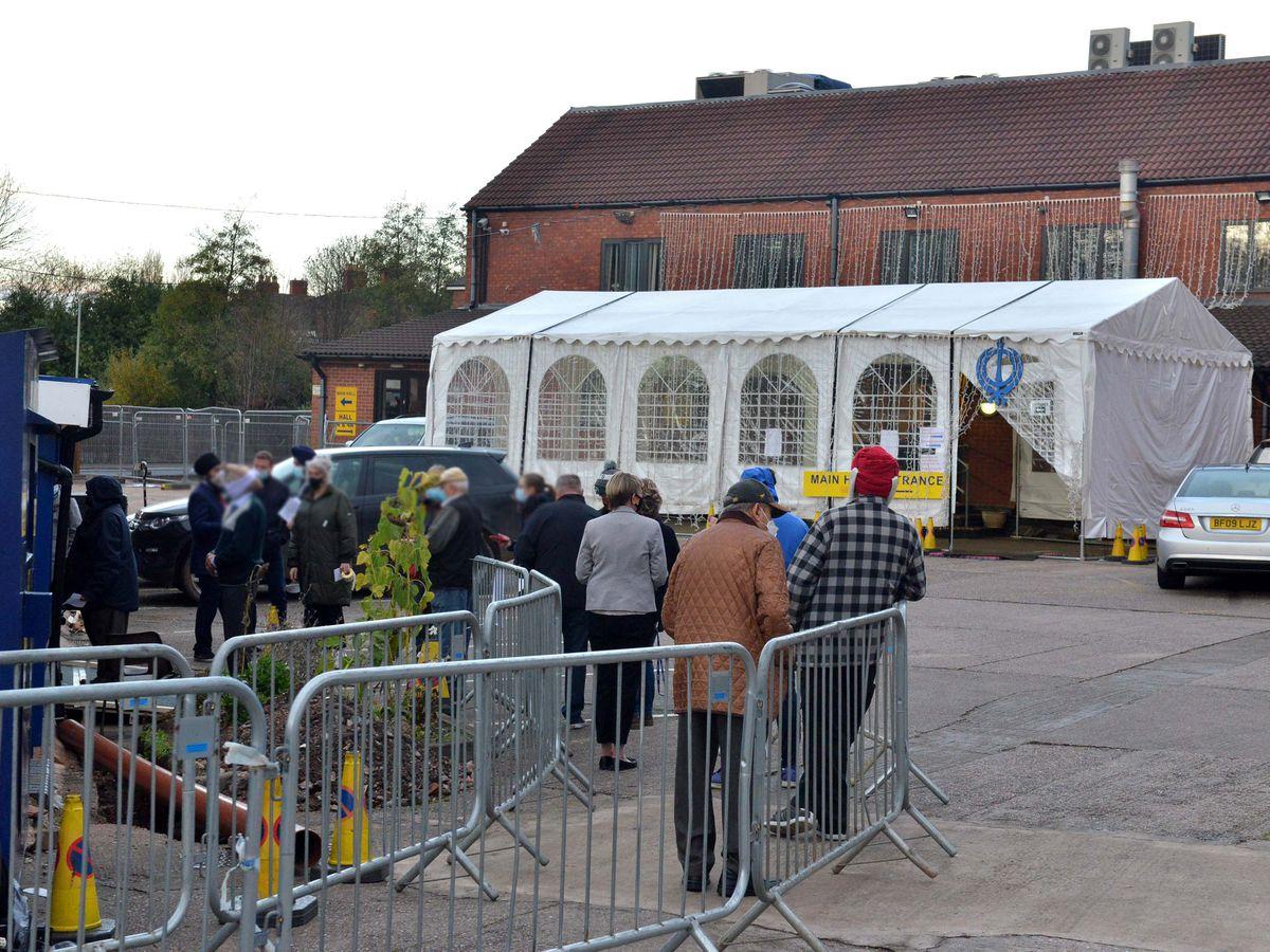 People queue to be tested at the Guru Nanak Sikh Gurdwara in Wolverhampton