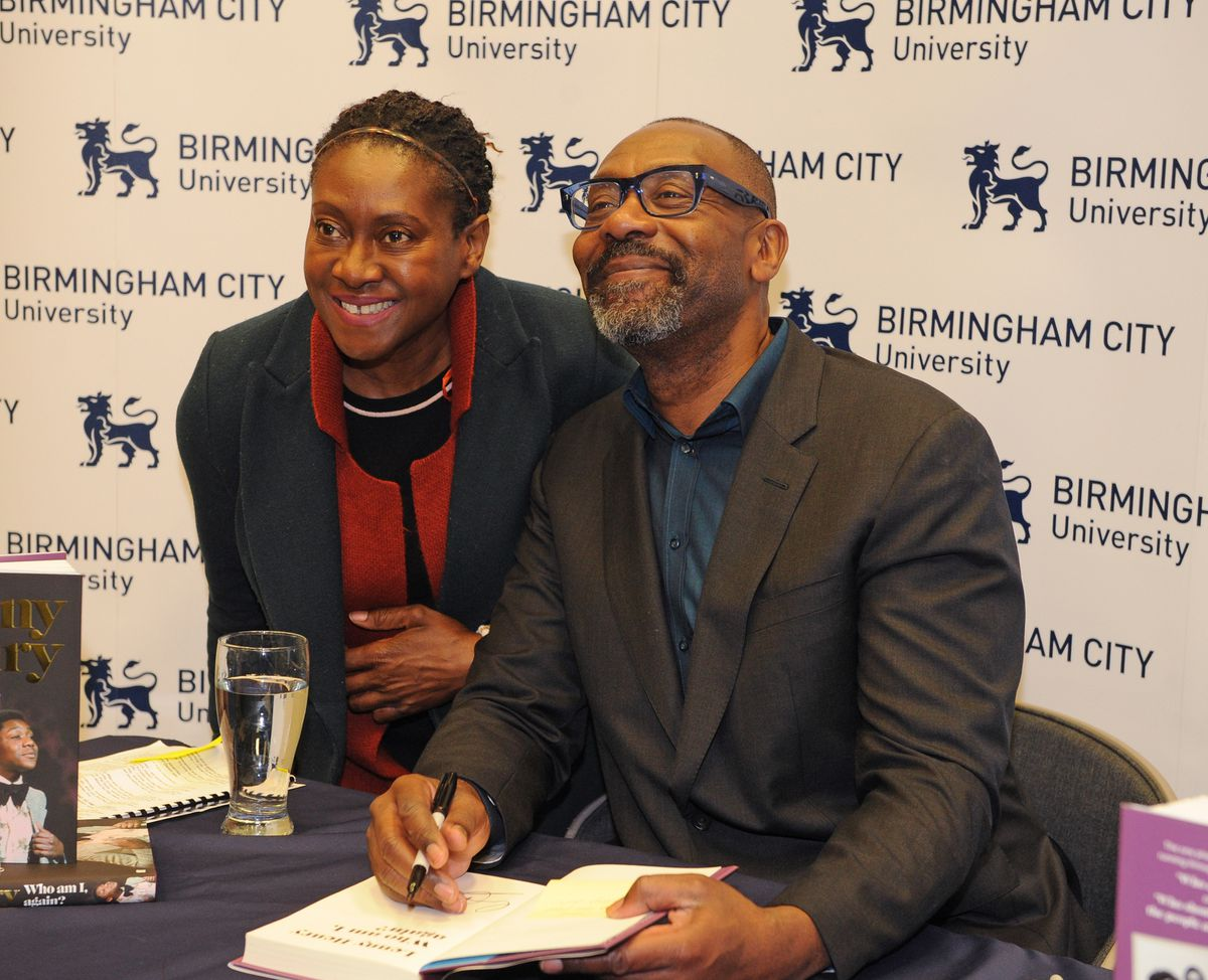 Sir Lenny Henry signs copies of his book for Lyn Edwards, from Wolverhampton