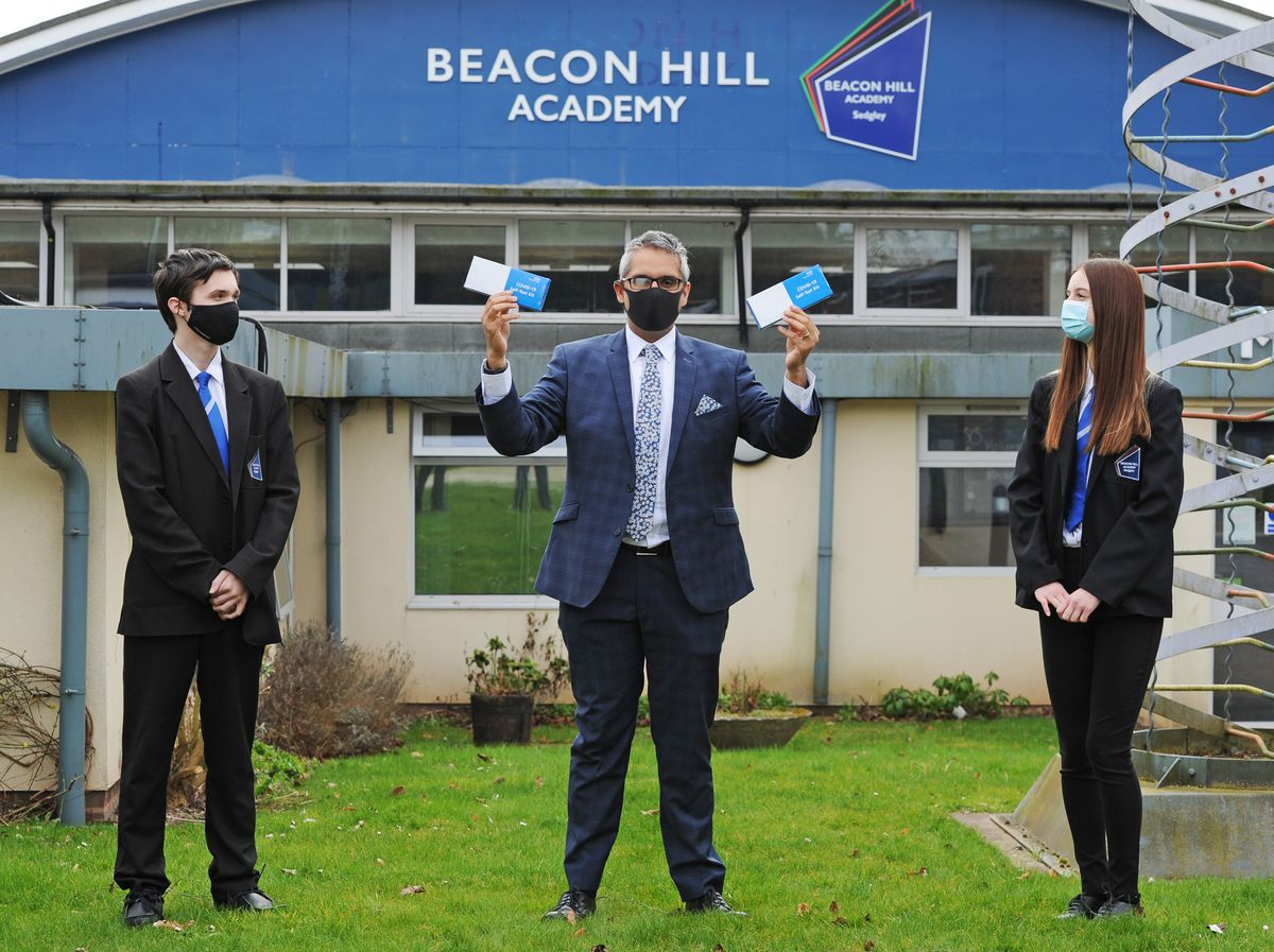 Students Bradley Totney and Evie Bourton with principal Sukhjot Dhami at the start of last term at Beacon Hill Academy, Sedgley