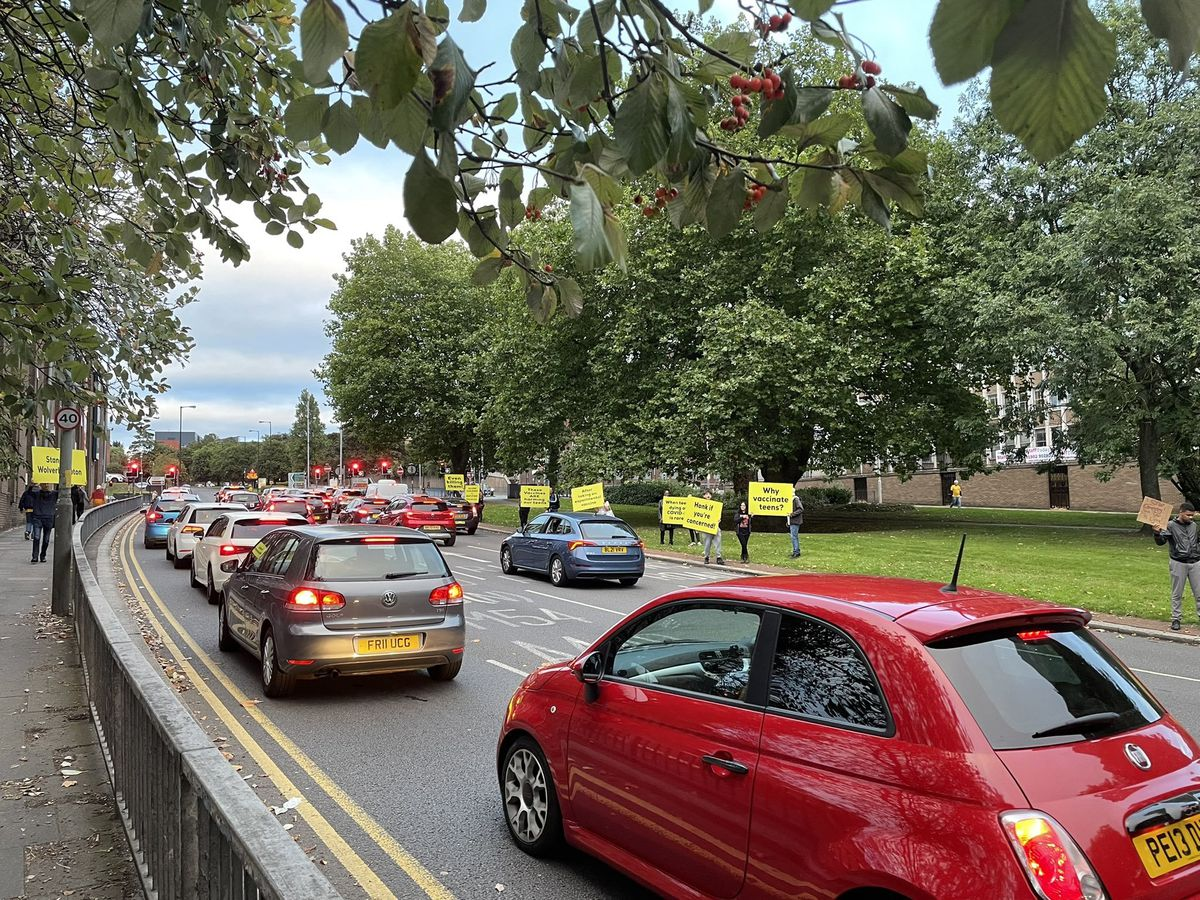 Anti-vaxxers protesting on Wolverhampton's Ring Road this evening. Photo: Aaron Humphriss