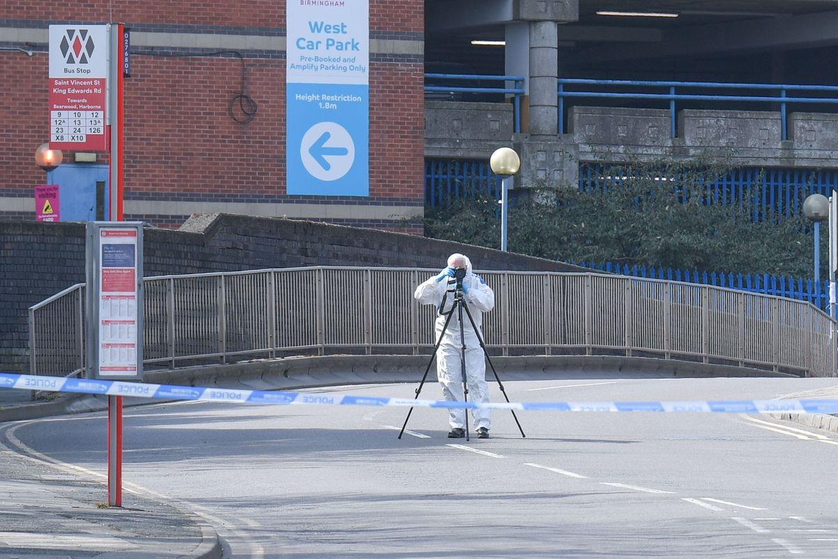 Police at the scene on St Vincent Road where a teenager was shot. Photo: SnapperSK