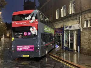The bus after it crashed into Sophie's Plaice, Dudley. Photo: West Midlands Fire and Rescue Service
