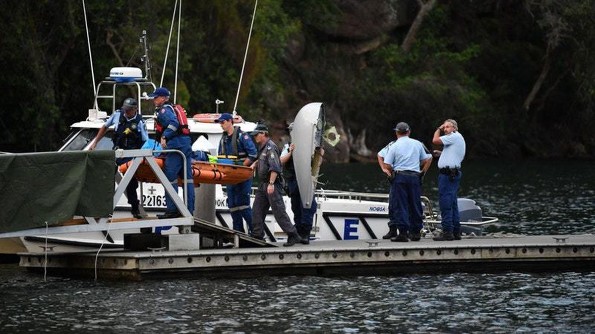 Search and rescue teams at the site on the Hawkesbury River (Perry Duffin/AAP/PA)