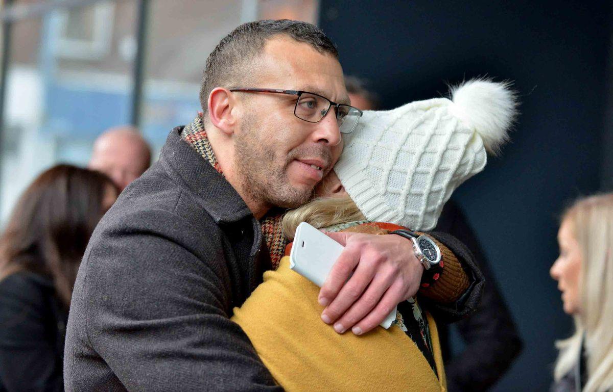 Campaigner Jason Connon hugs Ryan's aunt Susan Passey