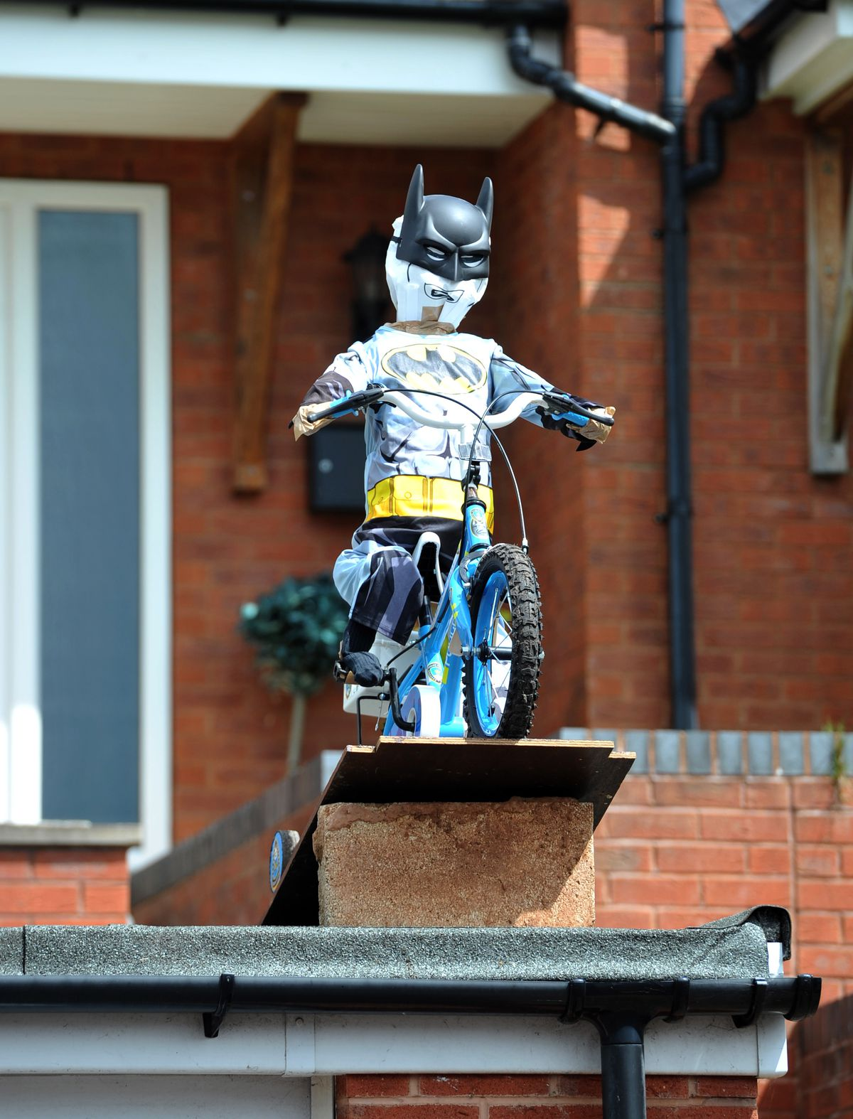 Dozens of scarecrows line the streets of Cresswell, Stafford, for a scarecrow competition
