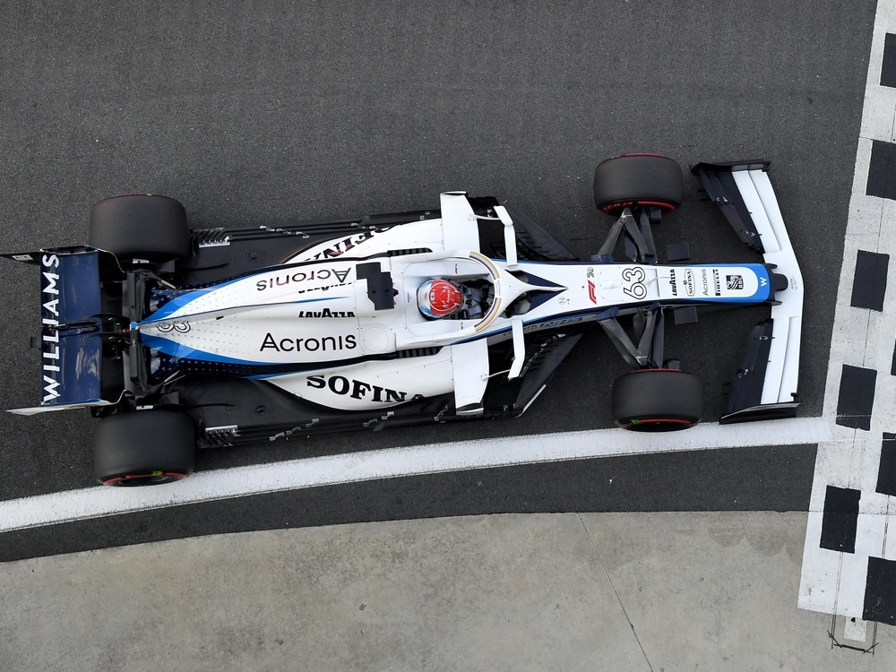 Claire Williams waves her cars out for one last time