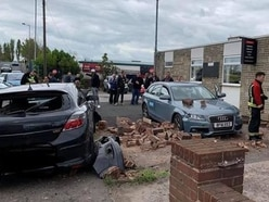 Man cut free after car smashes into wall and flips over outside Wolverhampton club